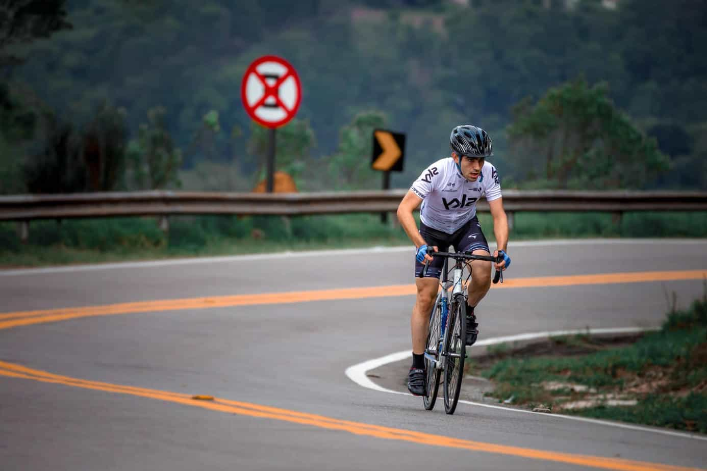 Cyclist biking uphill with strong mentality