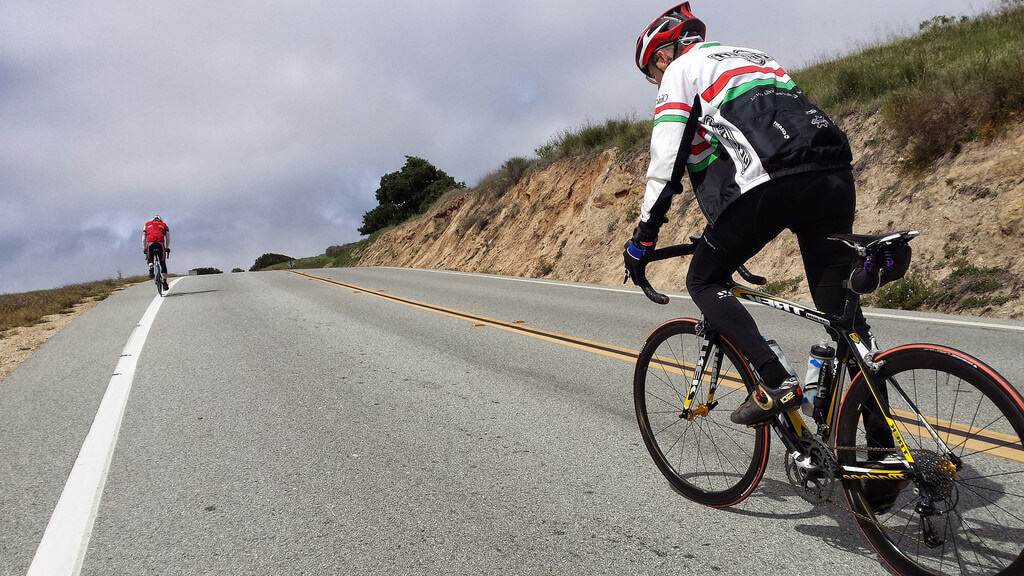 cyclist going uphill with body well positioned