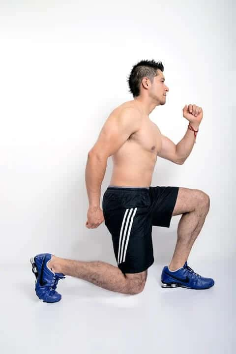 A man performing lunges to strengthen his knees.